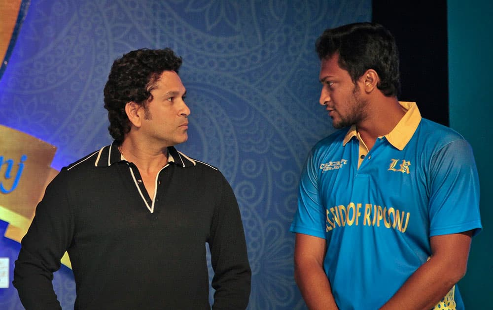 India's cricket icon Sachin Tendulkar, left, speaks to Bangladeshs Sakib Al Hasan during a promotional event in Dhaka, Bangladesh. Tendulkar Tuesday unveiled the logo of Dhaka Premier Division Cricket League champions `Legends of Rupganj.`