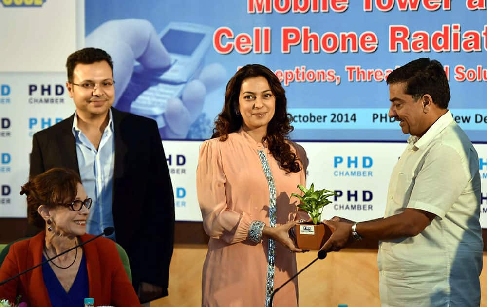 Juhi Chawla being gifted a sapling by Sr. Vice President of PHD Chamber Alok B Shriram during the Interactive Session on Mobile Tower and Cell Phone Radiations-Percepations,Threats and Solutions, in New Delhi.
