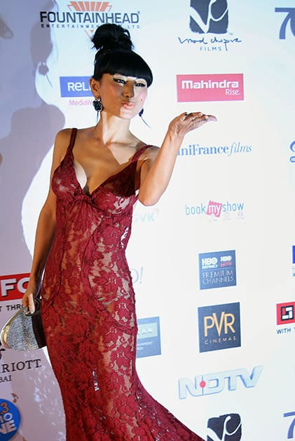 Chinese-born American actress Bai Ling arrives at the opening ceremony of the16th Mumbai Film Festival in Mumbai.