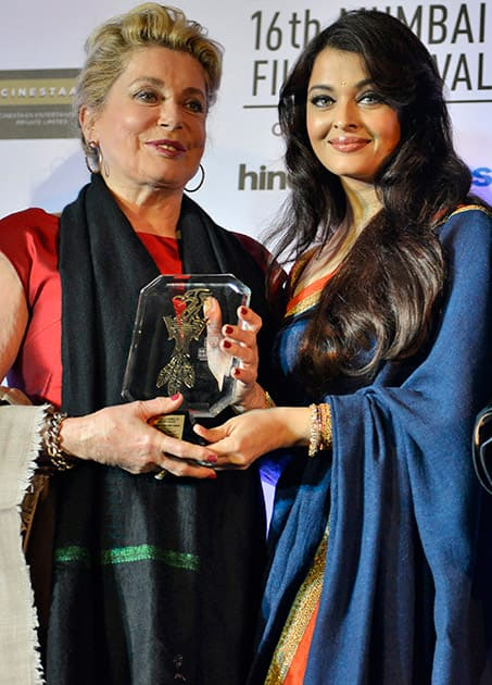 French actress Catherine Deneuve, receives the lifetime achievement award from Indian Bollywood actress Aishwarya Rai Bachchan during the opening ceremony of the 16th Mumbai Film Festival in Mumbai.