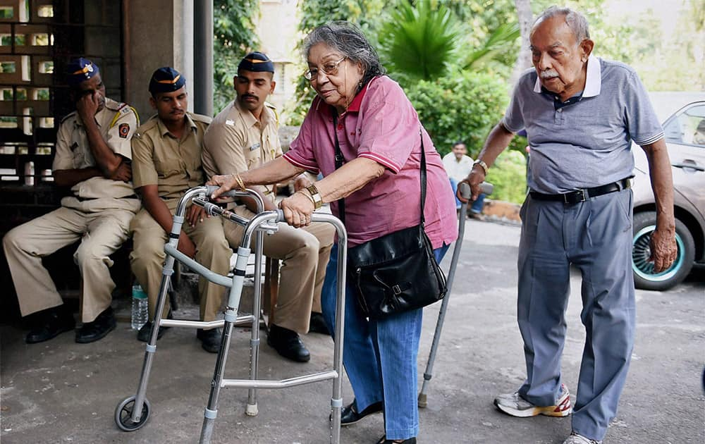 Senior citizens arrive to cast their vote for the Assembly elections in Mumbai.