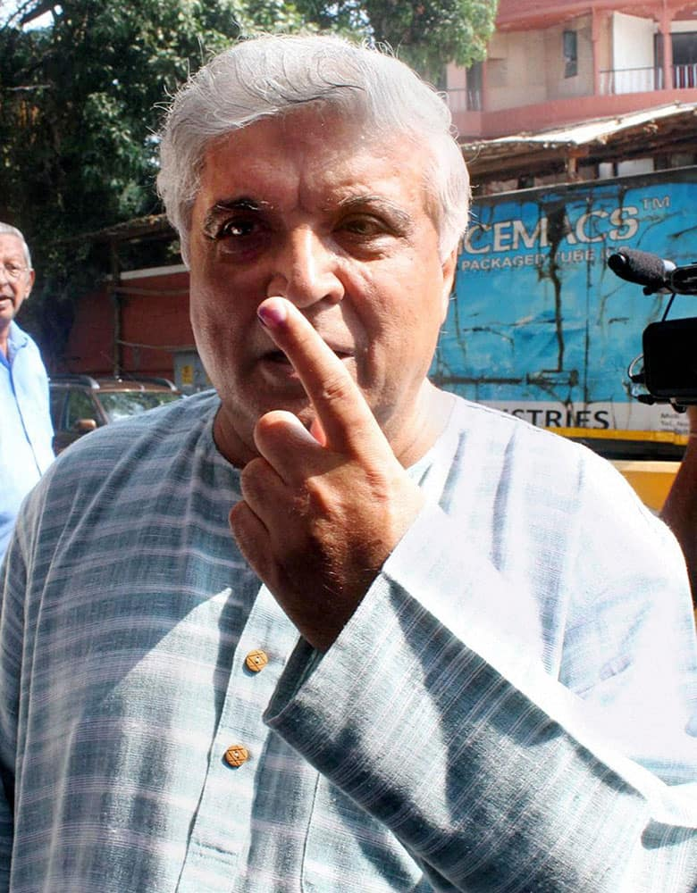 Lyricist Javed Akhtar shows his inked finger after casting his vote for the Assembly elections at a polling station in Mumbai on Wednesday.