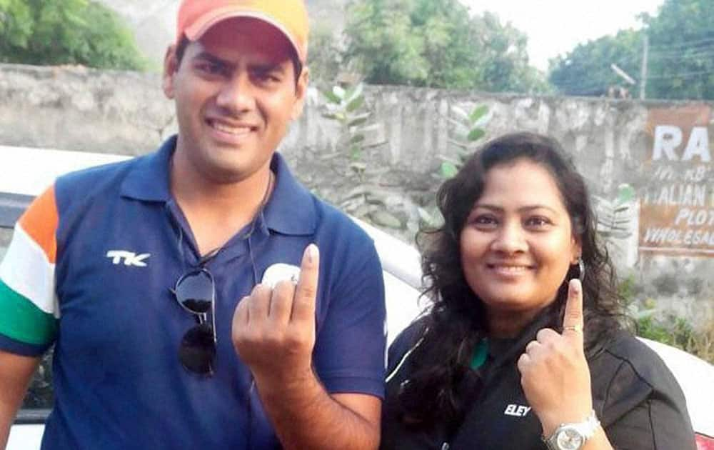 Shooter Anisha Sayyed with her husband after casting votes for Assembly elections in Faridabad on Wednesday.