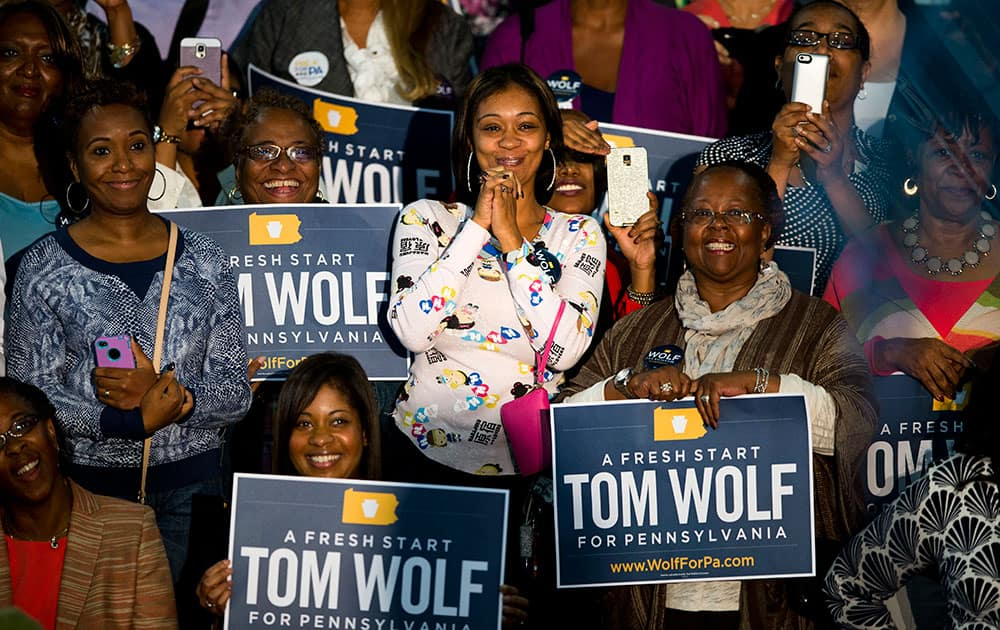 Audence members listen to first lady Michelle Obama campaign for Pennsylvania Democratic gubernatorial candidate Tom Wolf at the Dorothy Emanuel Recreation Center in Philadelphia.
