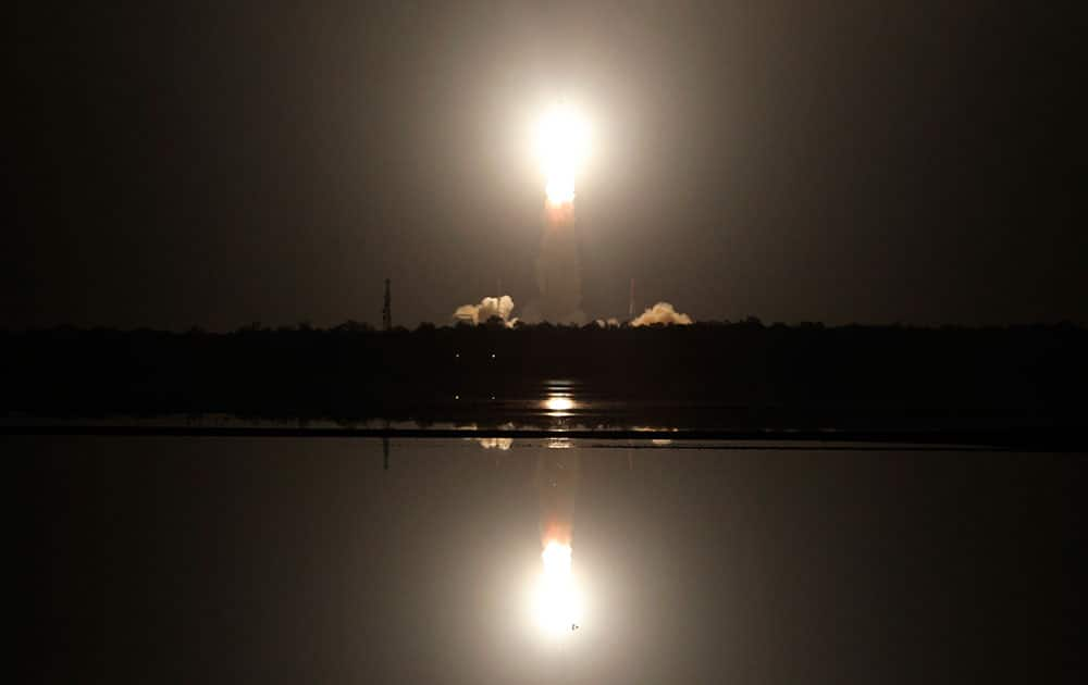Indian Space Research Organization's Polar Satellite Launch Vehicle (PSLV-C26) carrying India Regional Navigation Satellite System, lifts off from the Satish Dhawan Space Center in Sriharikota, Andhra Pradesh, India.