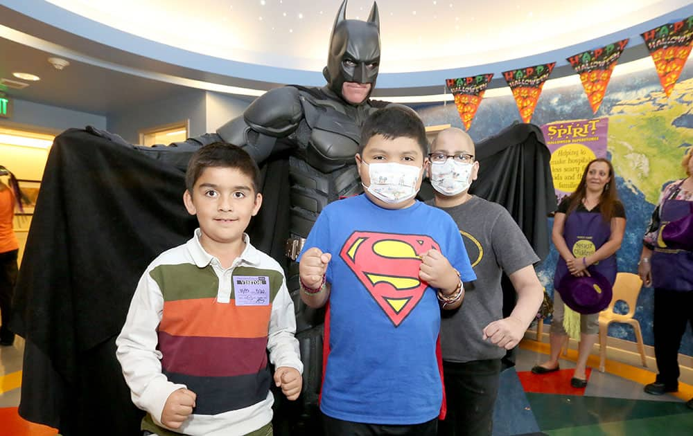 Batman visits and entertains patients for Halloween during a Spirit of Children party at Mattel Children's Hospital UCLA in Los Angeles.