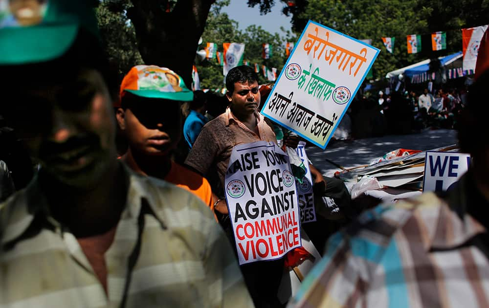 A supporter of All India Trinamool Congress (Youth) participates in an anti-government rally in New Delhi.