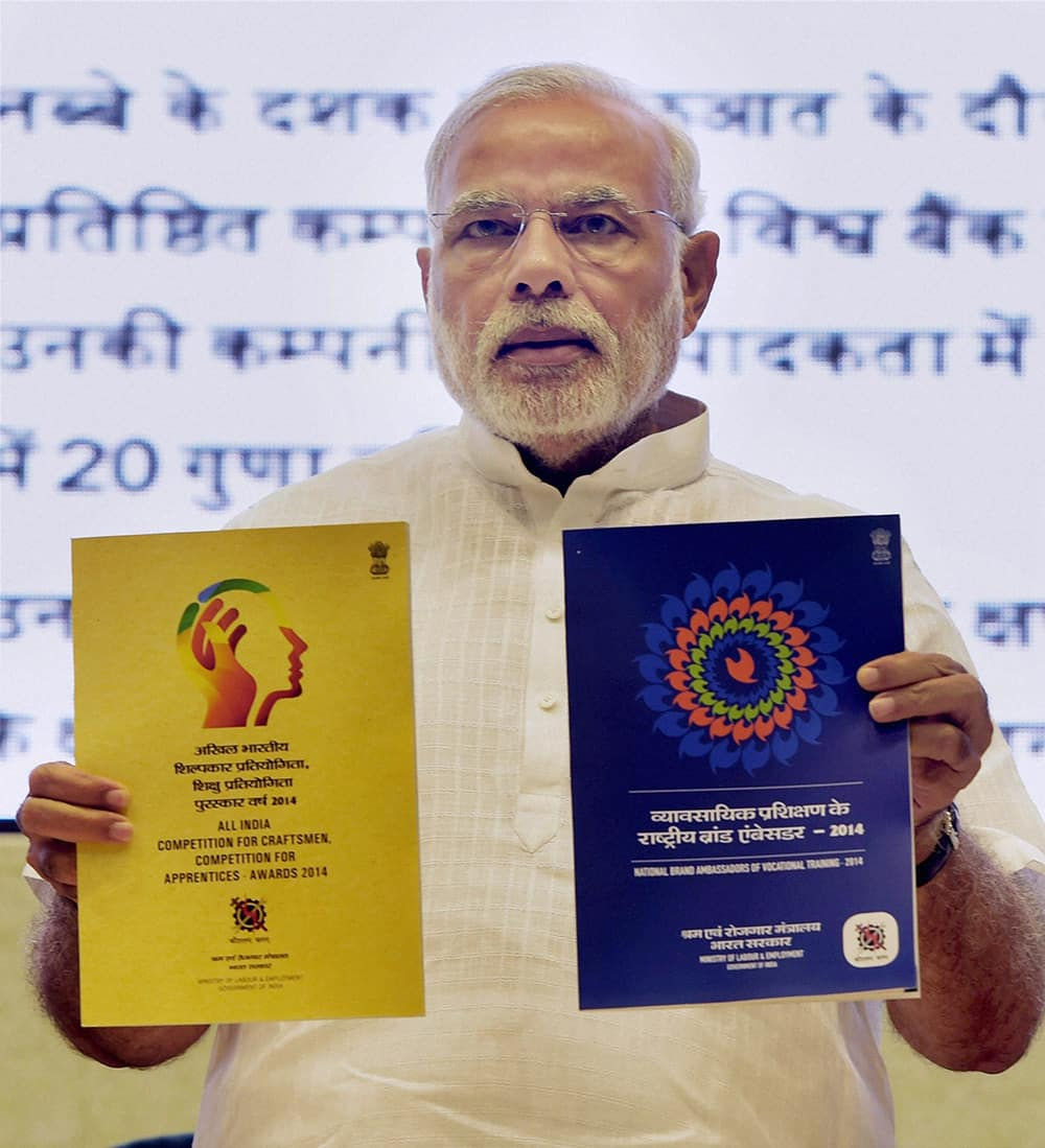 Prime Minister Narendra Modi releasing publications at the launch of Pandit Deendayal Upadhyay Shramev Jayate scheme in New Delhi.