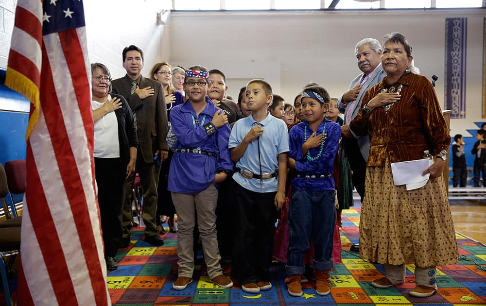 Students and faculty say the Pledge of Allegiance during an assembly at the Crystal Boarding School in Crystal, N.M. on the Navajo Nation.