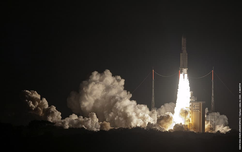 This photo provided by Service Optique CSG, the Ariane 5 lifts-off carrying the Argentine made ARSAT-1 geostationary communications satellite, from Kourou, French Guiana.
