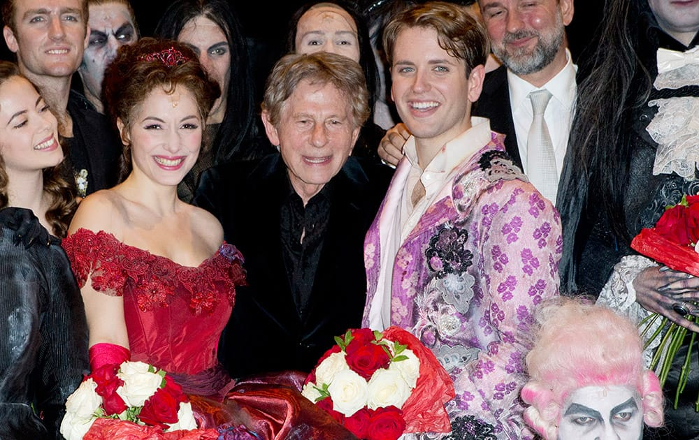 Director Roman Polanski, center, poses with Actress Rafaelle Cohen, playing Sarah, left, and Daniele Carta Mantiglia playing Alfred , right, at the end of the premiere of 'The Fearless Vampire Killers', in Paris.
