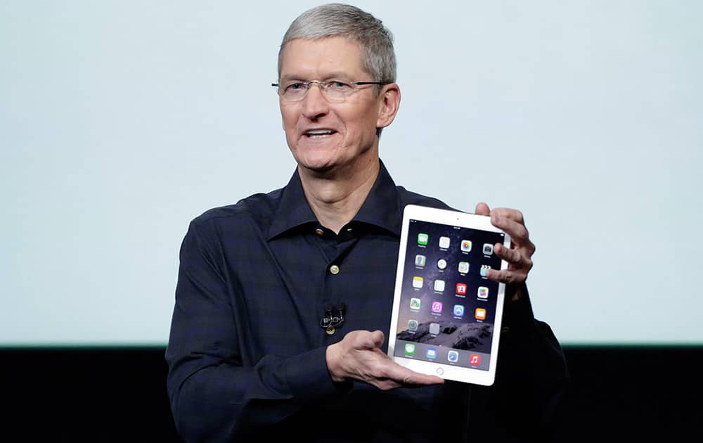 Apple CEO Tim Cook introduces the new Apple iPad Air 2 during an event at Apple headquarters.