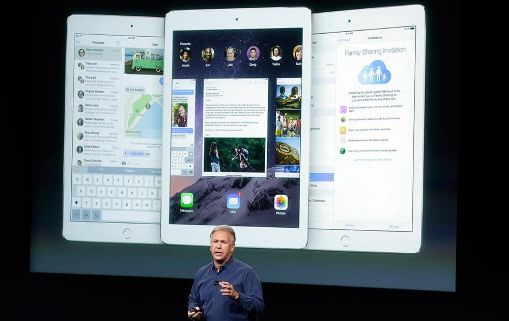 Phil Schiller, Apple's senior vice president of worldwide product marketing, discuss the features of the new Apple iPad Air 2 during an event at Apple headquarters.