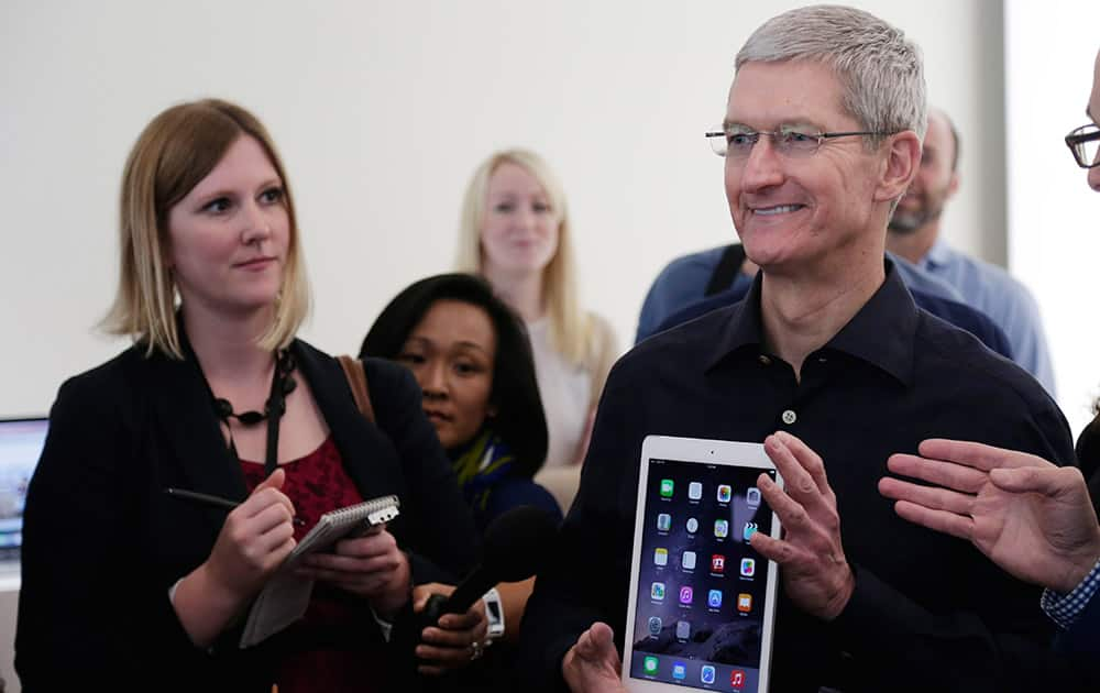 Apple CEO Tim Cook display the new iPad Air 2 at Apple headquarters.