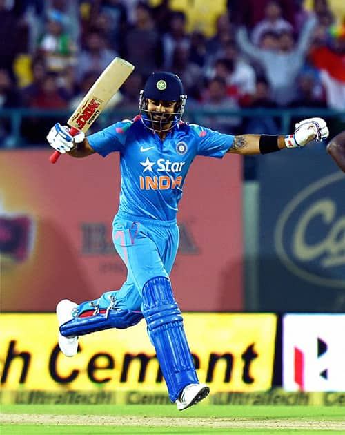 Indian batsman Virat Kohli celebrates his century during the India- West Indies ODI match, in Dharamshala.