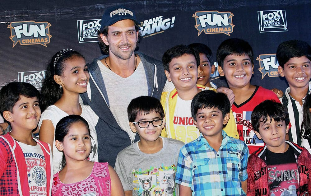 Bollywood actor Hrithik Roshan with kids during the special screening of film Bang Bang in Mumbai.