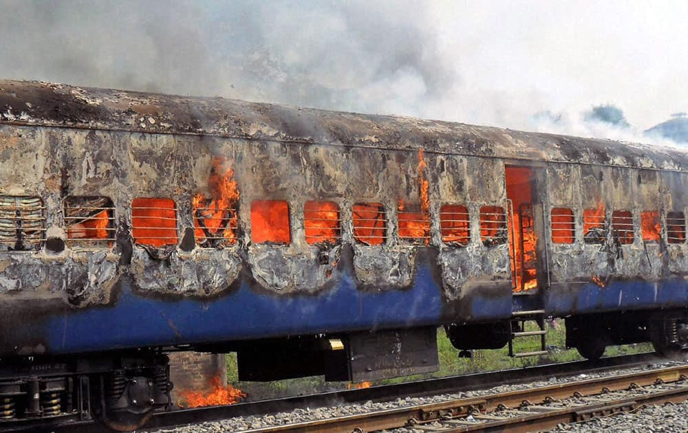 An Army Special Train in flames after its coaches caught fire at Chowki Railway Station.