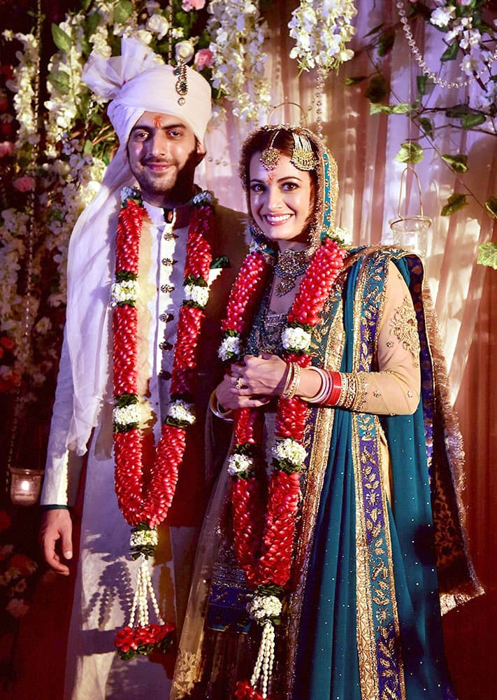 Bollywood actress Dia Mirza poses with her husband Sahil Sangha after their marriage.