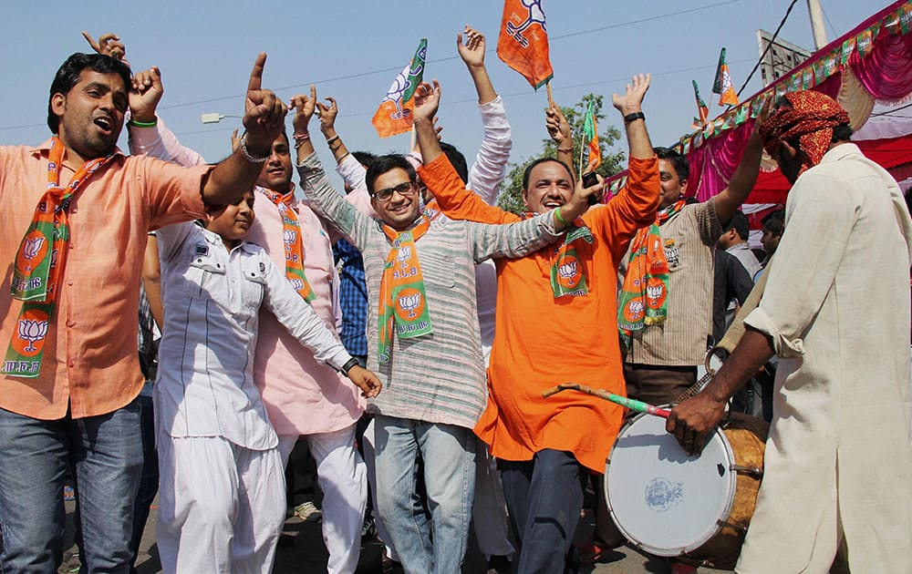 BJP workers dance while celebrating the party victory in the Assembly polls in Gurgaon.