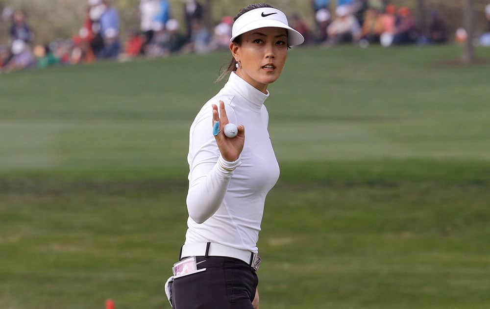 Michelle Wie of the United States reacts after sinking a birdie putt on the 18th hole during the final round of the KEB Hana Bank Championship golf tournament at Sky72 Golf Club in Incheon, South Korea.