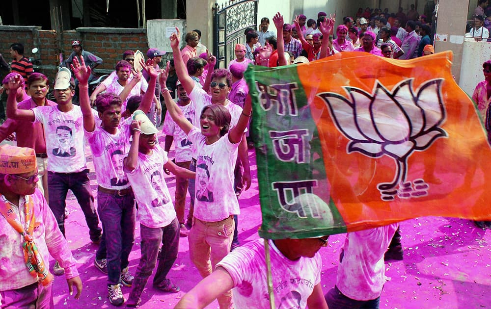 BJP supporters celebrate the partys victory in Assembly polls in Nagpur, Maharsahtra.