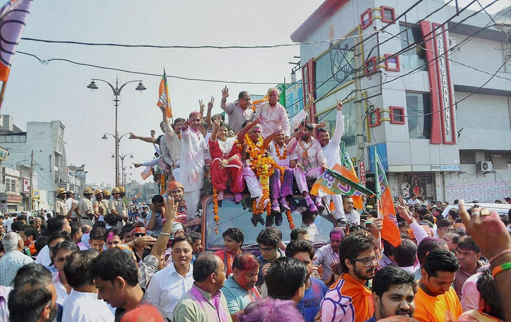 BJP candidate Manish Grover takes out a victory procession after his win in the Assembly polls in Rohtak.