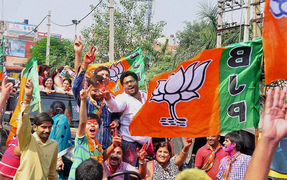 BJP workers celebrating the partys victory in the Assembly polls in Rohtak.