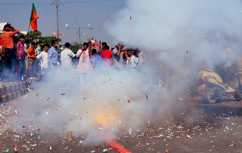 BJP workers celebrating their victory in the Assembly elections in Gurgaon.