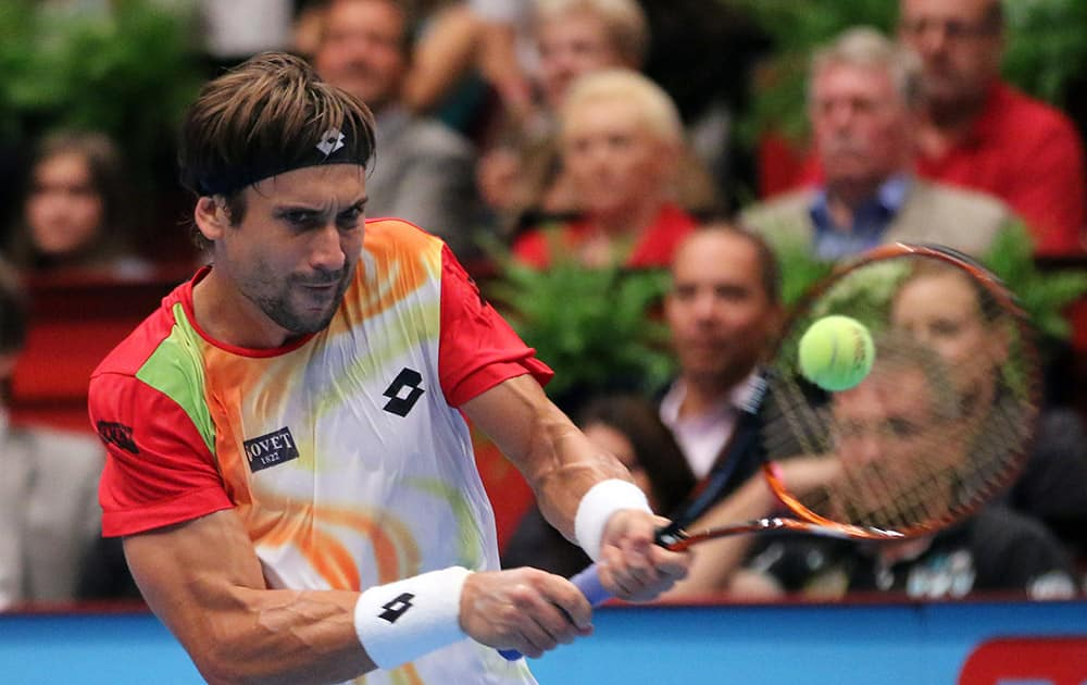 David Ferrer of Spain returns the ball to Andy Murray of Britain during their final match at the Erste Bank Open tennis tournament in Vienna, Austria.