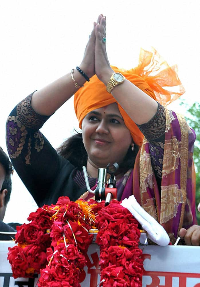 BJP candidate Pankaja Munde greets her supporters as she celebrates her victory in the Assembly elections in Parli.