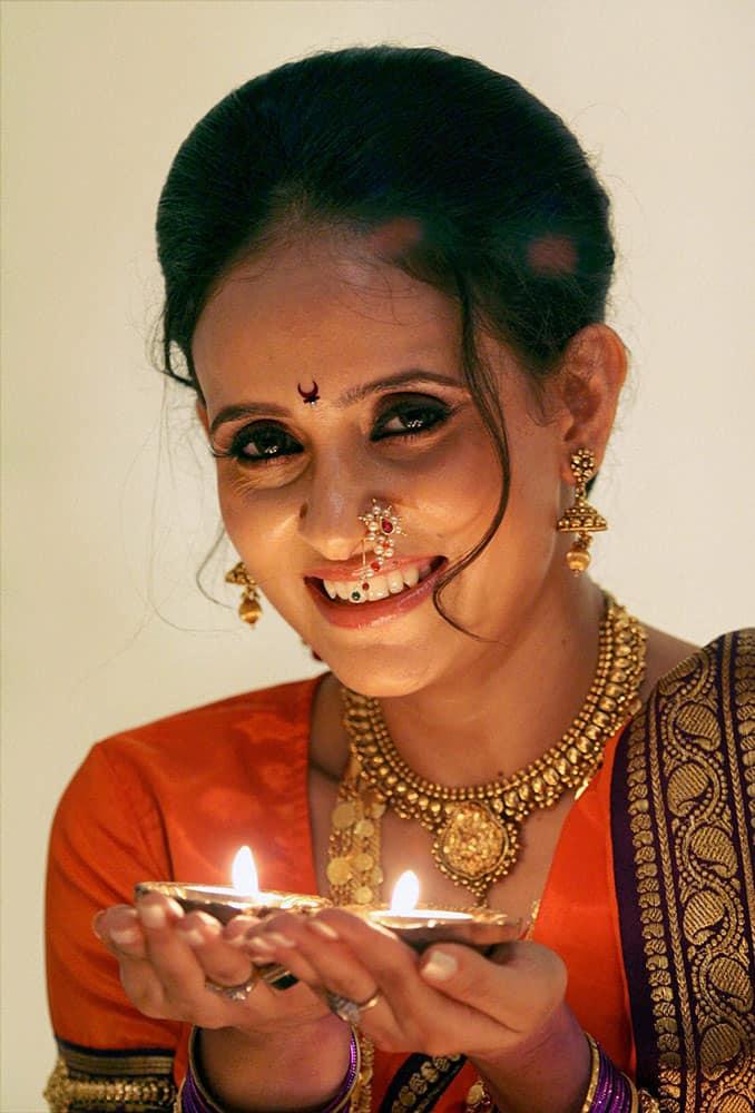 Bollywood Actress Shweta Khanduri poses with diya during a celebration of 'Diwali' festival, in Mumbai.