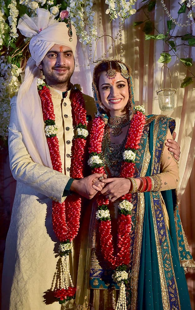 Bollywood actress Dia Mirza poses with her long-time beau Sahil Sangha after she got married in New Delhi.