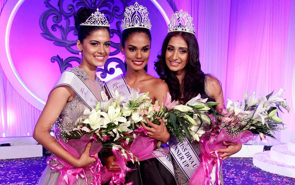 (L-R) ASHA BHAT, MISS DIVA UNIVERSE 2014 2ND RUNNER UP, NOYONITA LODH, MISS DIVA UNIVERSE 2014 WINNER, ALANKRITA SAHAI, MISS DIVA UNIVERSE 2014 1ST RUNNER UP POSE AFTER BEING CROWNED IN MUMBAI.