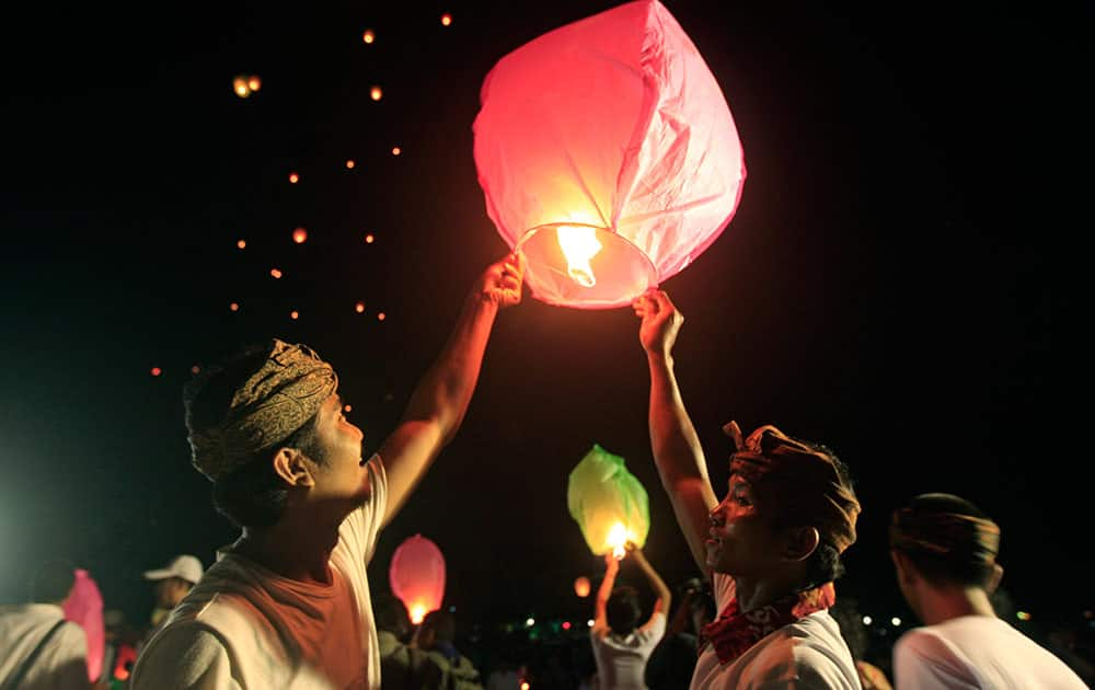 Supporters of Indonesian President Joko Widodo lifts paper lanterns before releasing into the air during a celebration after Widodo's inauguration as the country's seventh president in Bali, Indonesia.