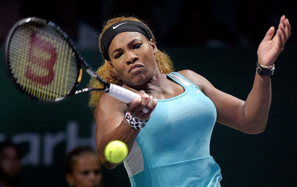 Serena Williams of the U.S. returns a shot against Ana Ivanovic of Serbia during their singles tennis match at the WTA Finals in Singapore. Williams won her opening match at the WTA Finals on Monday, beating Ivanovic 6-4, 6-4 in the Red Group for her 16th consecutive victory at the season-ending tournament.