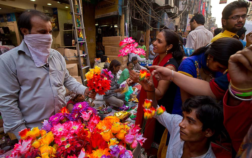 A woman buys plastic flowers to decorate her home on occasion of 'Diwali', the Hindu festival of lights, in New Delhi.