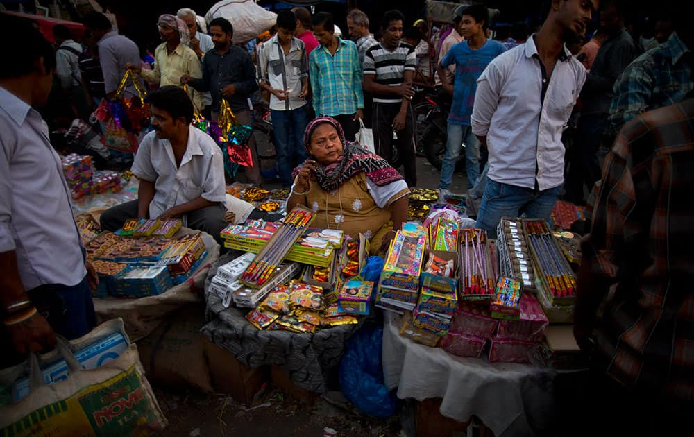 A vendor sells fire crackers ahead of 'Diwali', the Hindu festival of lights, in New Delhi.