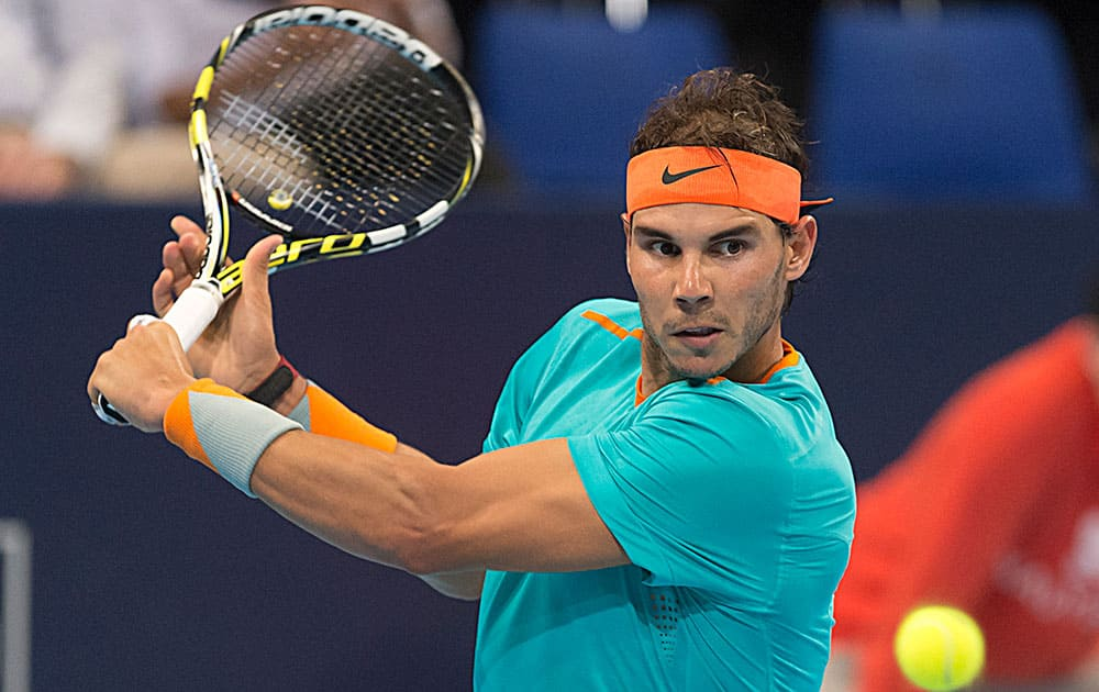 Spain's Rafael Nadal returns a ball to Italy's Simone Bolelli during their first round match in the Swiss Indoor tennis tournament at the St. Jakobshalle in Basel, Switzerland.