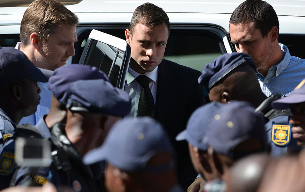 Oscar Pistorius, arrives outside the court in Pretoria, South Africa. Pistorius received a five-year sentence for culpable homicide by judge Thokozile Masipais for killing his girlfriend Reeva Steenkamp last year.