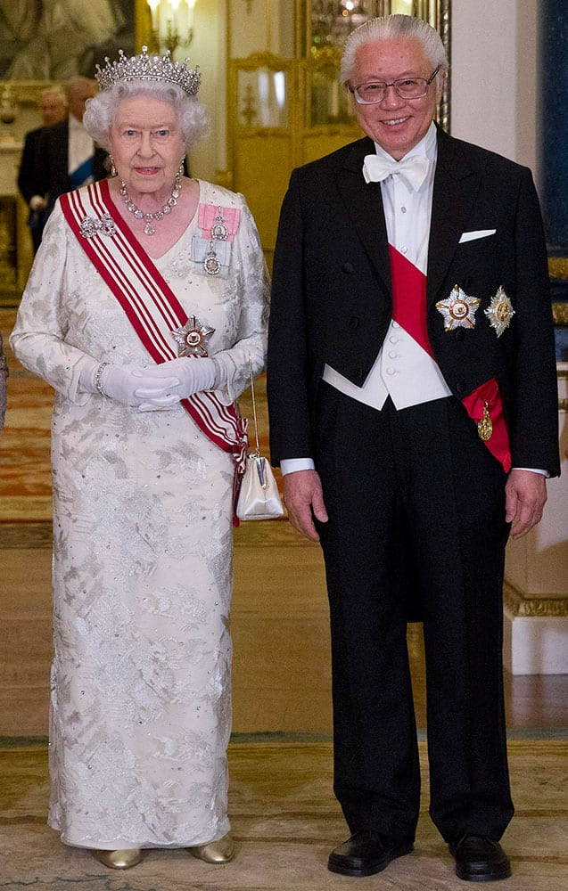 Britains Queen Elizabeth II poses for a photograph with Singapores President Tony Tan before a State Banquet at Buckingham Palace in London.