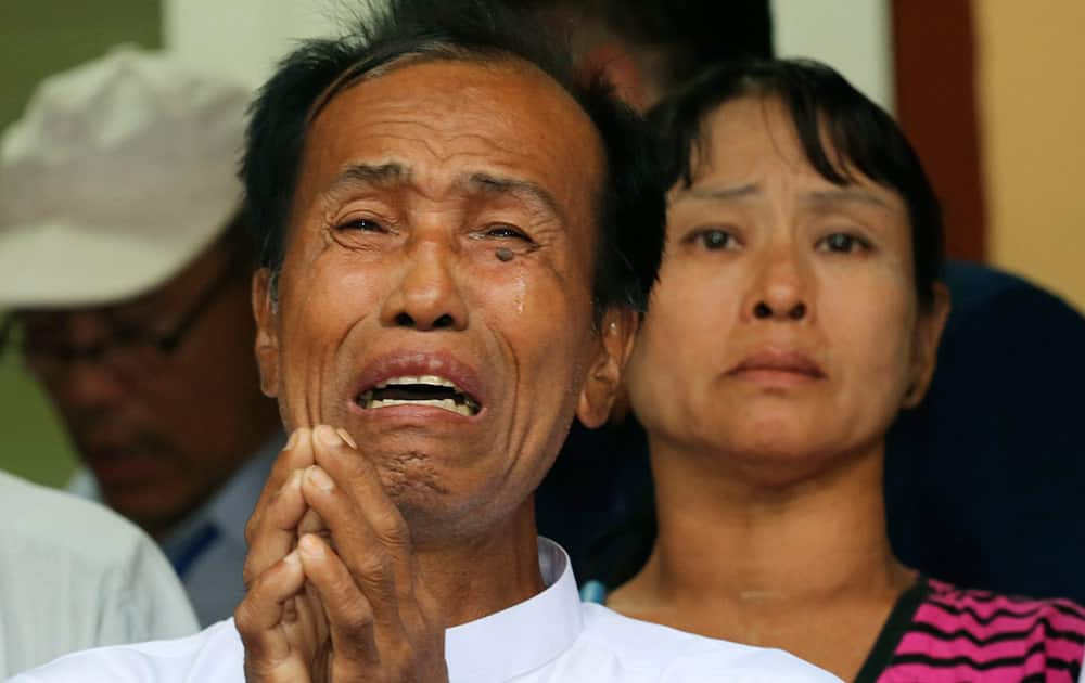 Tun tun Htike and May Thein, parents of Myanmar migrant worker Win Zaw Htun cry while addressing the media at the Myanmar Embassy in Bangkok ,Thailand. Myanmar migrant workers Win Zaw Htun and Zaw Lin, have retracted their confessions to killing two British travelers on a southern Thai resort island and now claim to have neither raped the female victim nor slain the pair, the men's lawyers said Wednesday.
