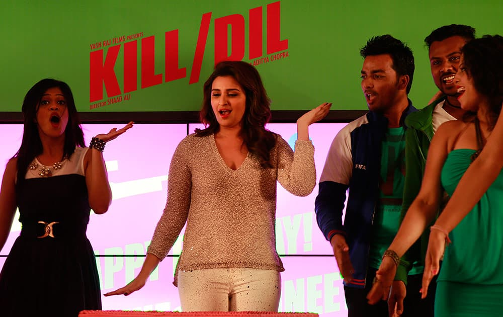 Parineeti Chopra dances with other artists during the song launch of her movie Kill Dil in Mumbai.