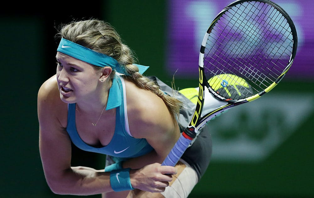 Canada's Eugenie Bouchard serves to Serbia's Anna Ivanovic during their singles match at the WTA tennis finals in Singapore.
