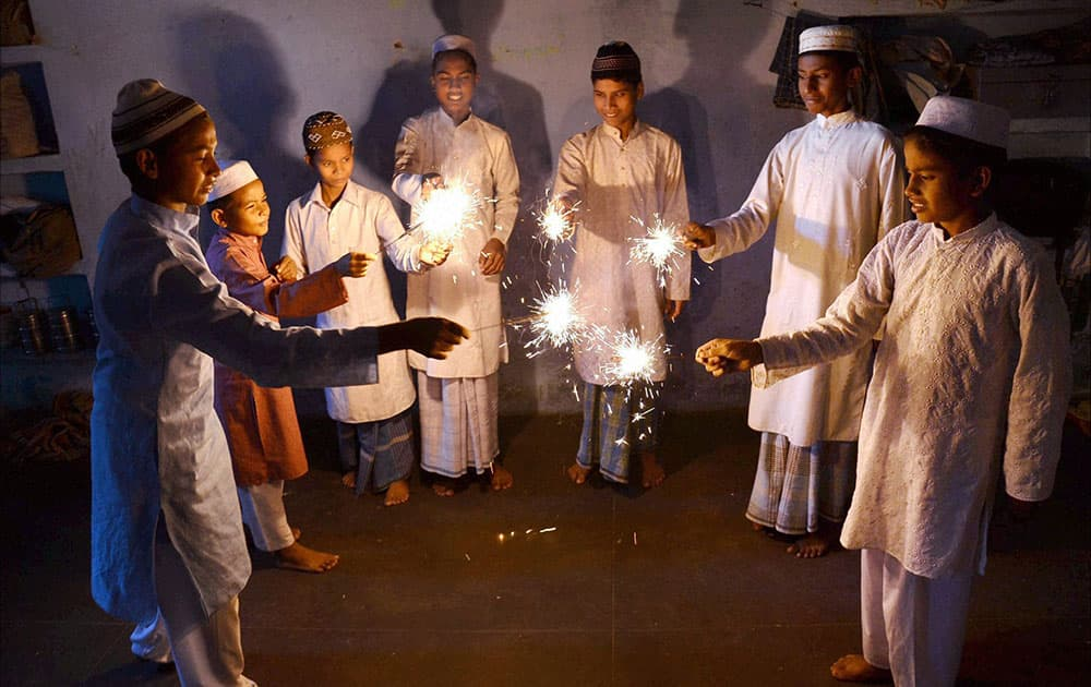 Muslim children celebrating Diwali with sparklers at a Madarsa in Mirzapur.