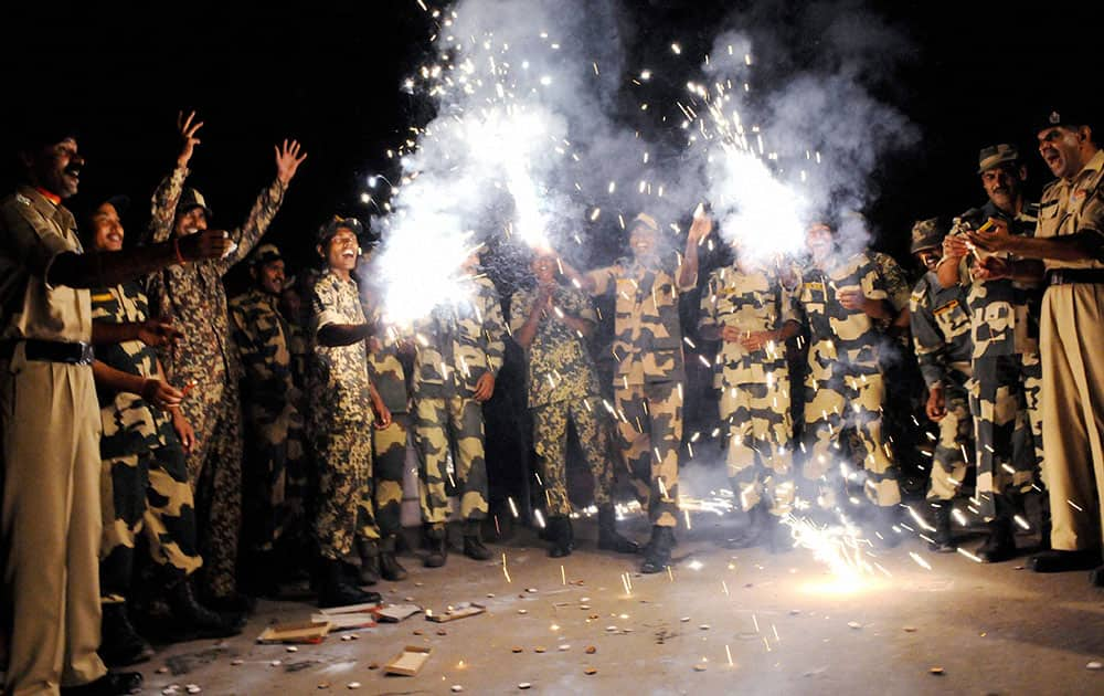 Border Security Force (BSF) soldiers enjoy Diwali celebrations on the eve of Diwali at the India-Bangladesh border post of Lankamura, about 5 kilometers (3 miles) from Agartala.