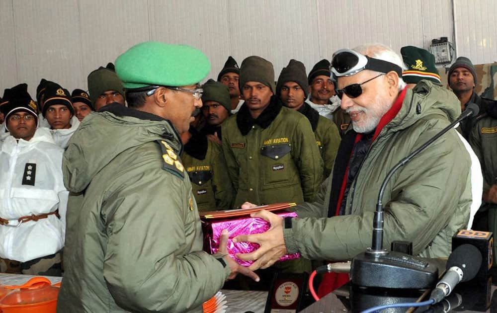 Prime Minister Narendra Modi exchanging Diwali gifts with the Officers and Jawans of Indian Armed Forces during his visit to Siachen on the occasion of Diwali.
