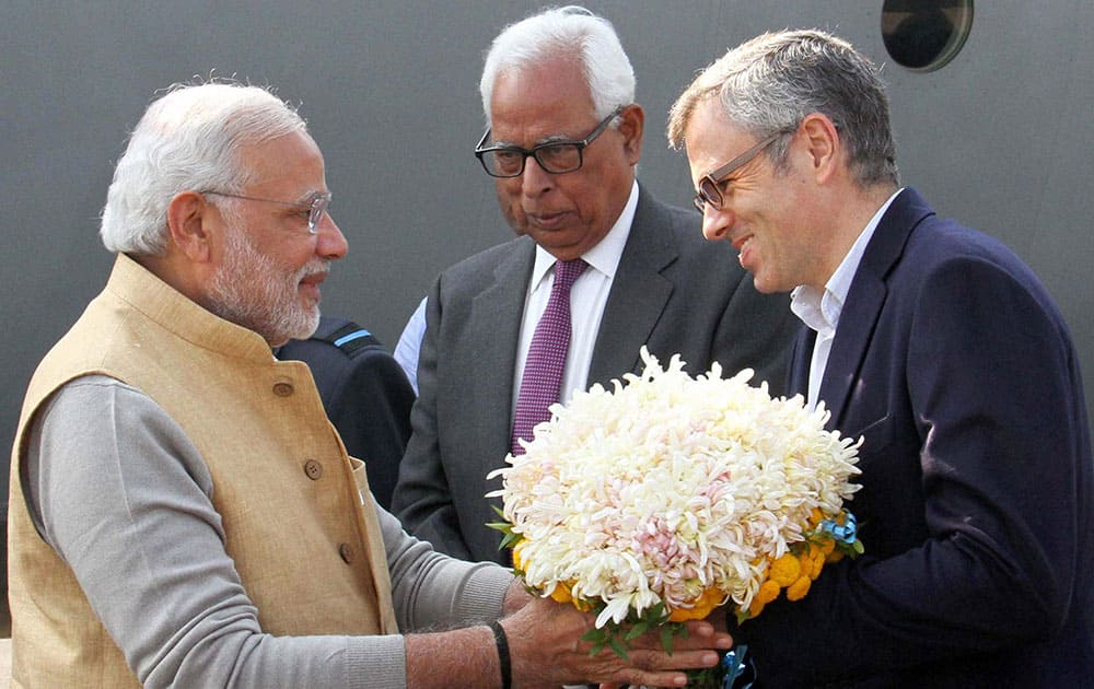 Prime Minister, Narendra Modi being received by Governor N. N. Vohra and Chief Minister Omar Abdullah at Airport in Srinagar.