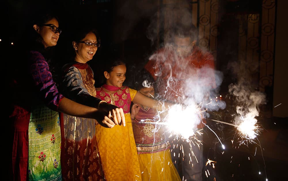 Indians play with firecrackers to celebrate Diwali in Allahabad, India.