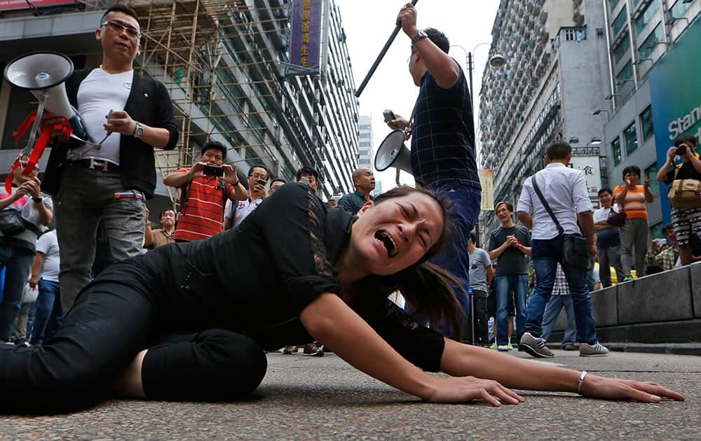 Anti-occupied protesters demand to remove the barricade in the occupied area in the Mong Kok district of Hong Kong.