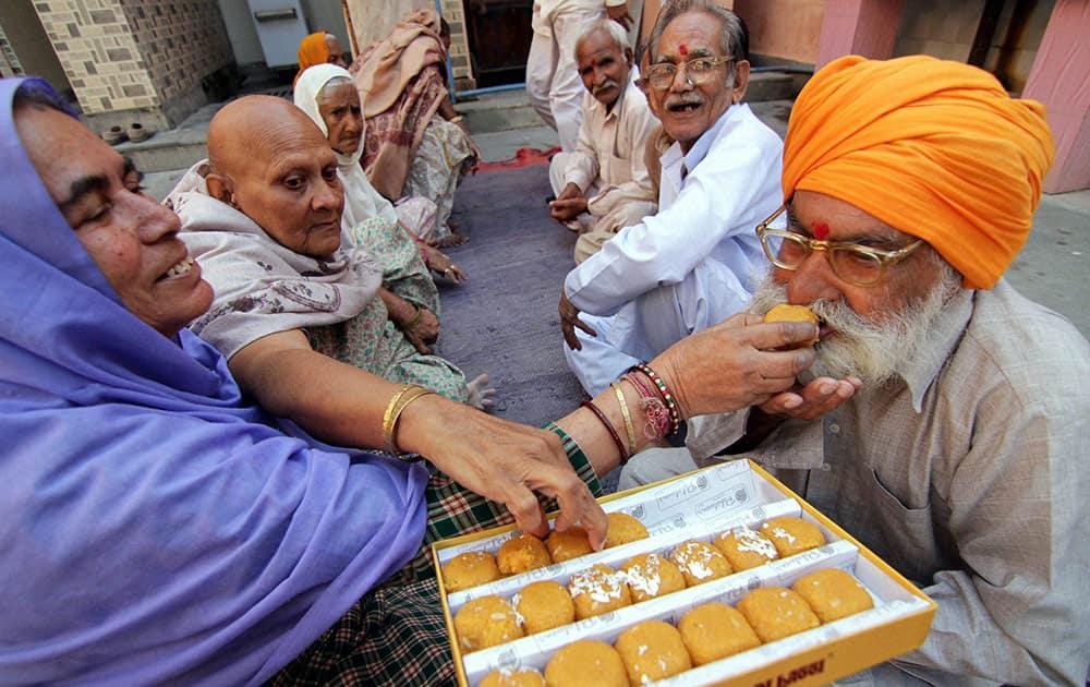 Women of old home celebrate Bhai Dooj festival, in Jammu.
